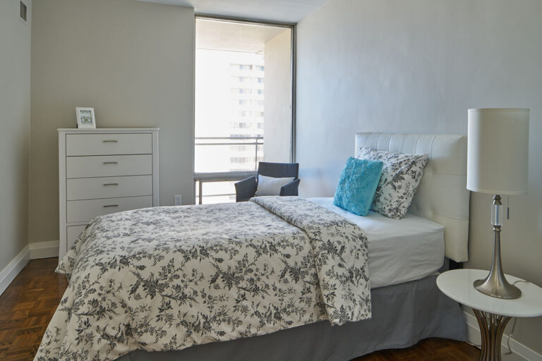 Bedroom with large window in luxury two bedroom apartment - The Summerhill at Yonge & St. Clair