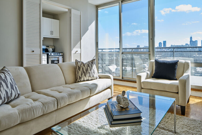 Living room with view in one bedroom apartment - The Summerhill at Yonge & St. Clair