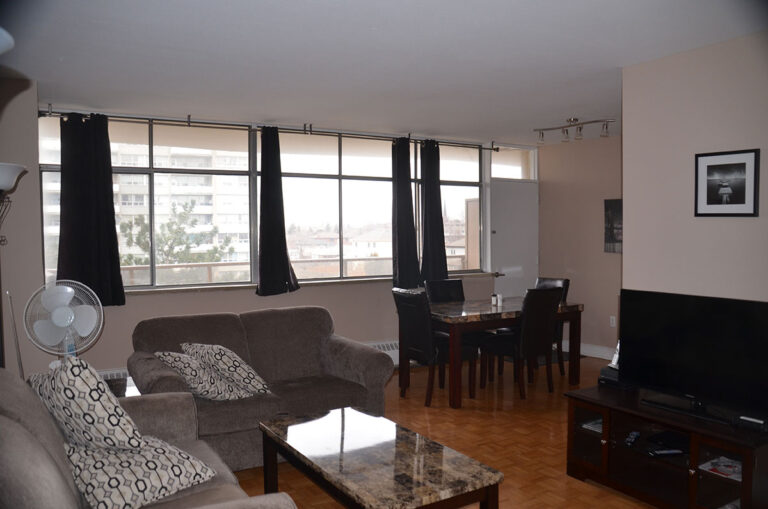 Open living & dining space in three bedroom apartment - Humber River Apartments near Keele & Wilson