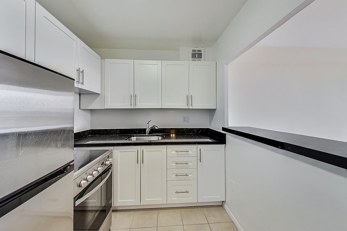 Modern kitchen in jr. one bedroom apartment - The Summerhill at Yonge & St. Clair
