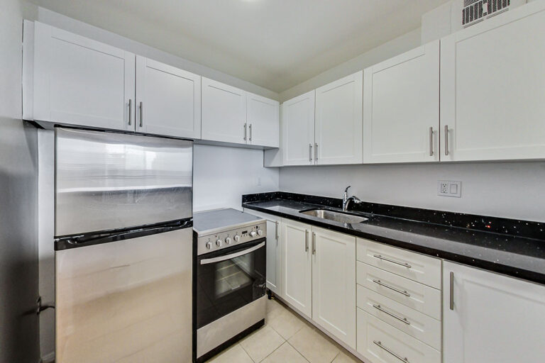 Kitchen with stainless steel appliances in jr. one bedroom apartment - The Summerhill at Yonge & St. Clair