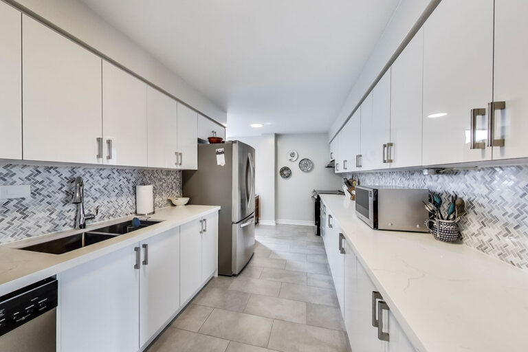 Galley kitchen in luxury penthouse apartment - The Summerhill at Yonge & St. Clair