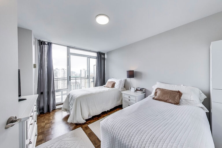 Bedroom with balcony in luxury penthouse apartment - The Summerhill at Yonge & St. Clair