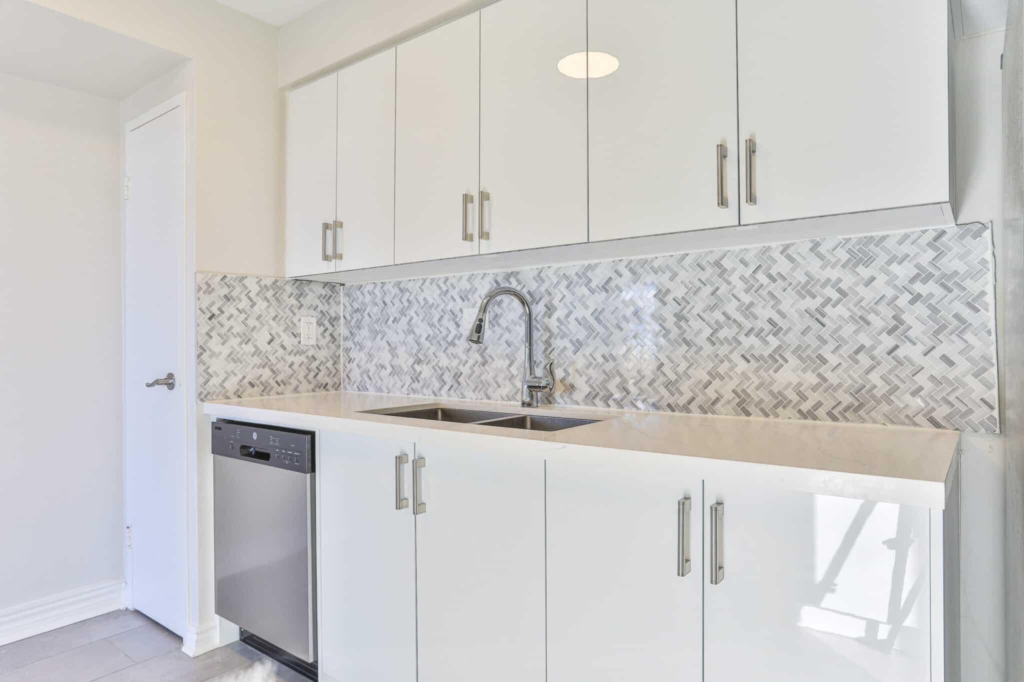 Penthouse Renovated White Kitchen with Quartz Counter